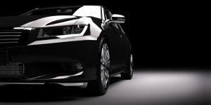 Fotolia 128643483 Subscription Monthly M 300x150 - New black metallic sedan car in spotlight. Modern desing, brandless.